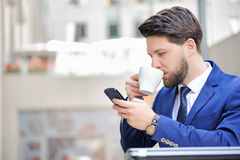 Pleasant young man sitting in cafe Royalty Free Stock Photo