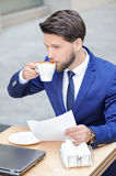 Pleasant young man sitting in cafe Royalty Free Stock Image