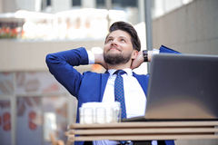 Pleasant young man sitting in cafe Royalty Free Stock Images
