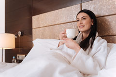 Pleasant young woman lying in her bed Stock Image