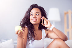 Pleasant young woman talking on cell phone Royalty Free Stock Photo