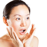 Pleasantly surprised expression. The pleasantly surprised look of a beautiful Asian woman royalty free stock images