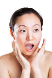 Pleasantly surprised expression. The pleasantly surprised look of a beautiful Asian woman stock photo