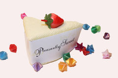 Pleasantly Sweet cake slice. A slice of cake with a strawberry on top that reads Pleasantly Sweet royalty free stock image