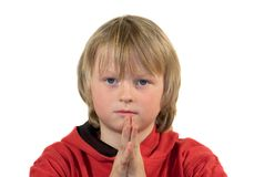 Please.. Boy with pleading expression and folded hands Royalty Free Stock Photography