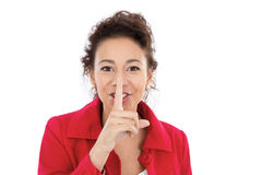 Please be quiet. Woman shows please be quiet sign, isolated on white Royalty Free Stock Image