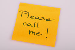 Please call me note on orange sticker note on white Royalty Free Stock Photo