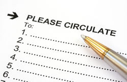 Please Circulate. Blank circulation list, with gold and silver ballpoint pen.  Close-up view Stock Images