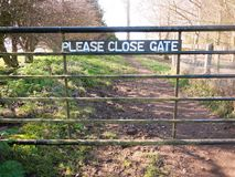 Please close gate sign on metal closed gate outside country way. Essex; england; uk stock images