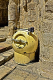 Please Deposit Bombs Here. Bomb Receptical by entrance to the Church of the Holy Sepulchre in Old Jerusalem, Israel. Public safety measure to help defend against royalty free stock photography