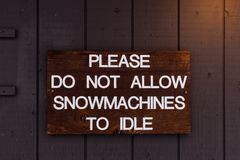 A Please do not allow Snowmachines to idle sign royalty free stock photo