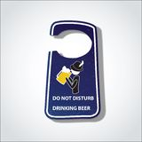 Please do not disturb drinking beer  sign (hotel hanger sign) Stock Photo