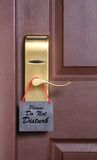 Please do not disturb message on cardboard tag. Please do not disturb message, a common request for others not to disturb the motel or resort room occupants, on royalty free stock photos