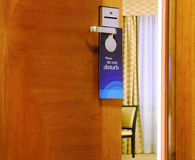 Please do not disturb sign hanging on open door Stock Photo