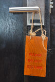 Please do not disturb sign on wood Stock Image