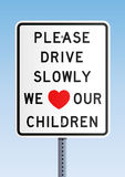Please drive slowly we love our children Stock Photography