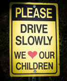 Please drive slowly we love our children Sign Royalty Free Stock Images