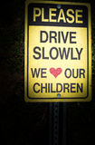 Please drive slowly we love our children Sign Royalty Free Stock Photography