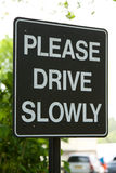 Please Drive Slowly Sign. A sign asking drivers to Please Drive Slowly stock images