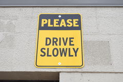 Please Drive Slowly Yellow And Black Sign Stock Photography