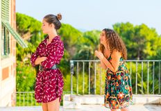 Please forgive me. Two young female girls having a vivid conversation on the park. A vivid argument and discussion between friends. Asking an offended friend to royalty free stock images