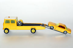 Please help me with my car. Picture of a salvage car towing a car.Toys are from the 1970's or 80's. From my brothers toy collection Royalty Free Stock Images