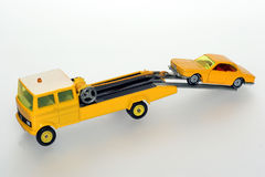 Please help me with my car #2. Picture of a salvage car towing a car.Toys are from the 1970's or 80's. From my brothers toy collection Royalty Free Stock Photography