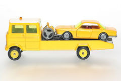 Please help me with my car #3. Picture of a salvage car towing a car.Toys are from the 1970's or 80's. From my brothers toy collection Royalty Free Stock Photo
