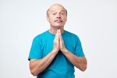 Please help me now. Bald mature man saying need a help stock photography