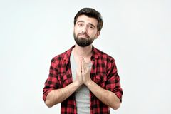 Please help me now. Bearded hispanic mature man with beard need a help. Studio shoot stock photos