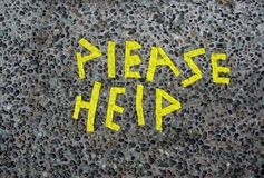 Please Help words. On an asphalt Royalty Free Stock Images