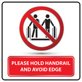 Please hold handrail and avoid edge sign  Stock Photo