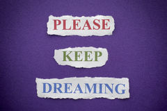 Please Keep Dreaming. Phrase on purple background with vignette royalty free stock photos
