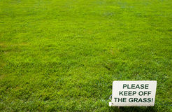 Please keep of the grass lettering sign on green background Stock Photo