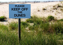 Please Keep Off The Dunes sign Stock Photo