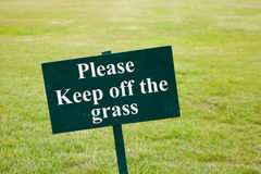 Please keep off the grass sign. Green grass Stock Image