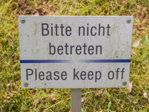 Please keep off from the grass sign Stock Image