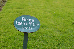 Please keep off the grass sign. Stock Images