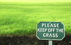 Please keep off the grass royalty free stock photo
