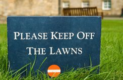 Please keep off the lawns � stone sign in the park Royalty Free Stock Photo