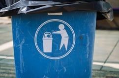 Please litter into bins symbol. Outdoor stock image