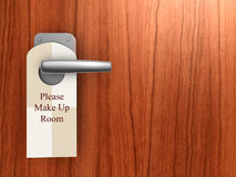 Please make up room sign on hotel door. Handle stock photography