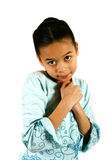 Please, may I have some more. A young girl showing the emotion of pleading or wanting something through body gesture, both hands clasp close to her body, strong Stock Photos