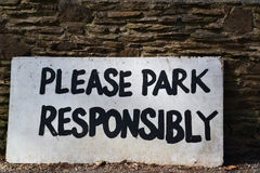 Please Park Responsibly Sign. As many other places in this world parking can be a problem, so as it says park, but please do it responsibly Stock Image