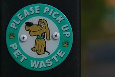 Please pick up pet waste sign. In green colored circle stock photo