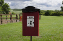 Please pick up your dog mess. Dog mess bin in the local park, highlighting issues against dog muck in the area Stock Images