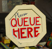 Please Queue Here Sign Stock Photos