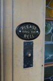 Please ring the door bell sign. Stock Image