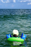 Please select a destination. A child looking out at the vast ocean, he can go anywhere from here Royalty Free Stock Photo