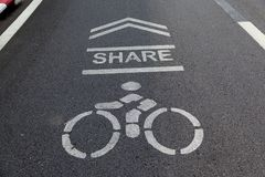 Please share bike lanes for bikers.bicycles sign in the park. Stock Photos